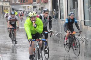 I'd hit 1 pot hole too many, with just 9 miles to go I got a front puncture and this photographer captured the moment